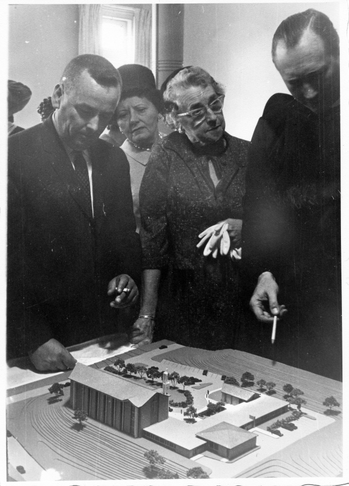 Architect's Model of the Hackett Boulevard building. Kenneth Eells (left) and J. Raymond McWilliam (right)